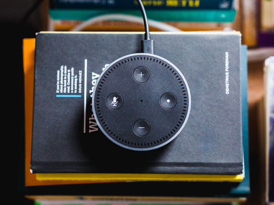 Amazon Echo on top of books