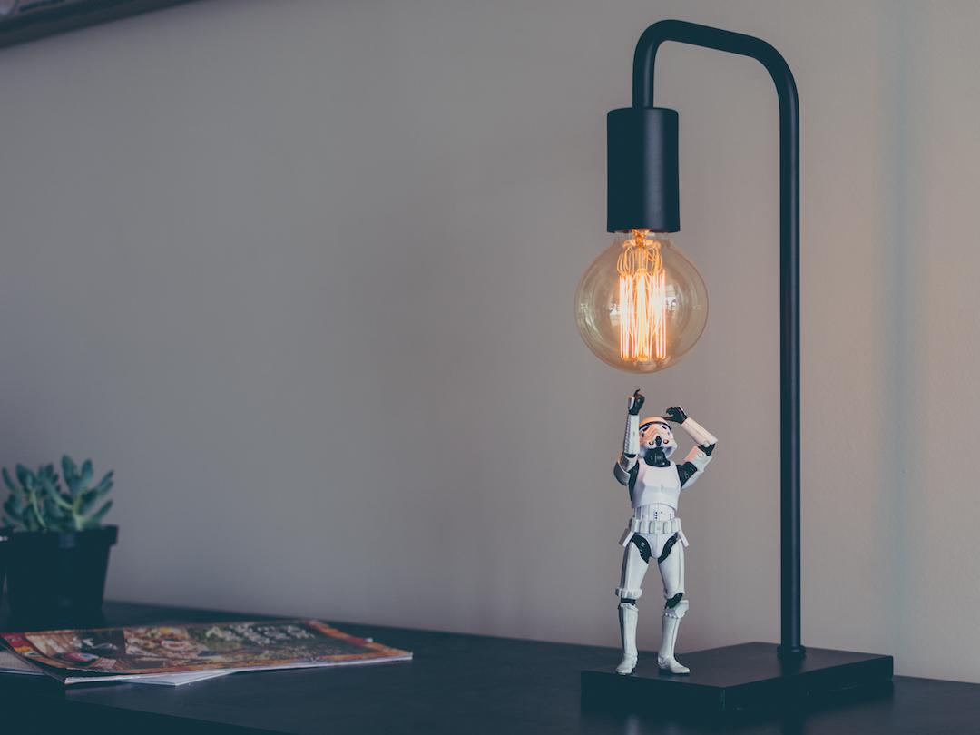 An action figure under a lightbulb