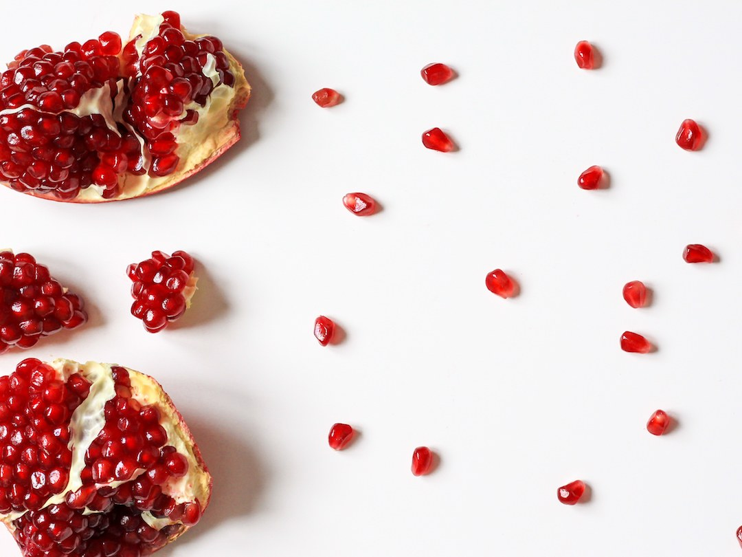 A broken pomegranate on a white background