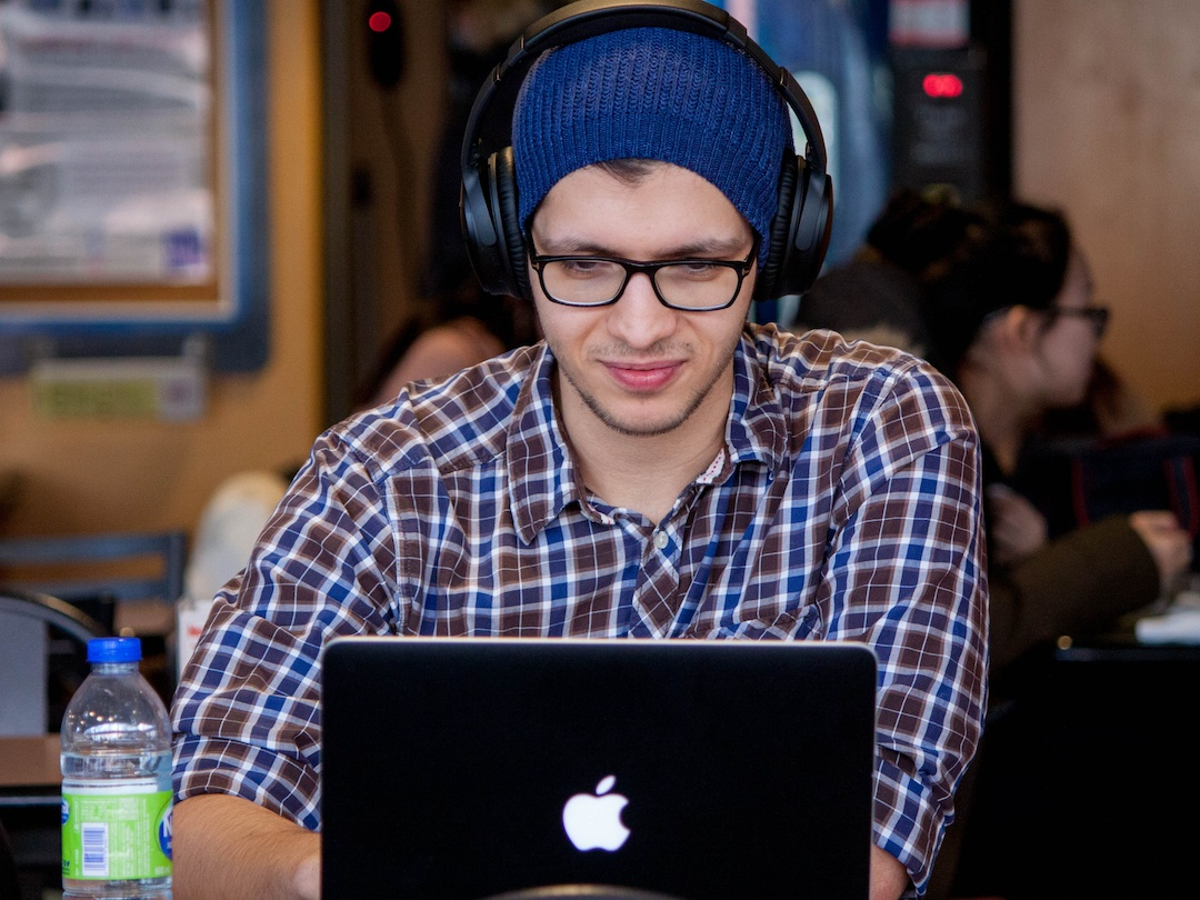 man with laptop and headphones